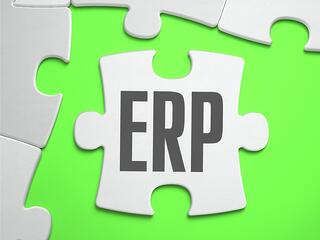 ERP - Enterprise Resource Planning - Jigsaw Puzzle with Missing Pieces. Bright Green Background. Close-up. 3d Illustration..jpeg